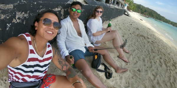 Day traveling through SE Asia > Having a beer on a beach in Koh Phi Phi, Thailand > TheRoamingNoodle