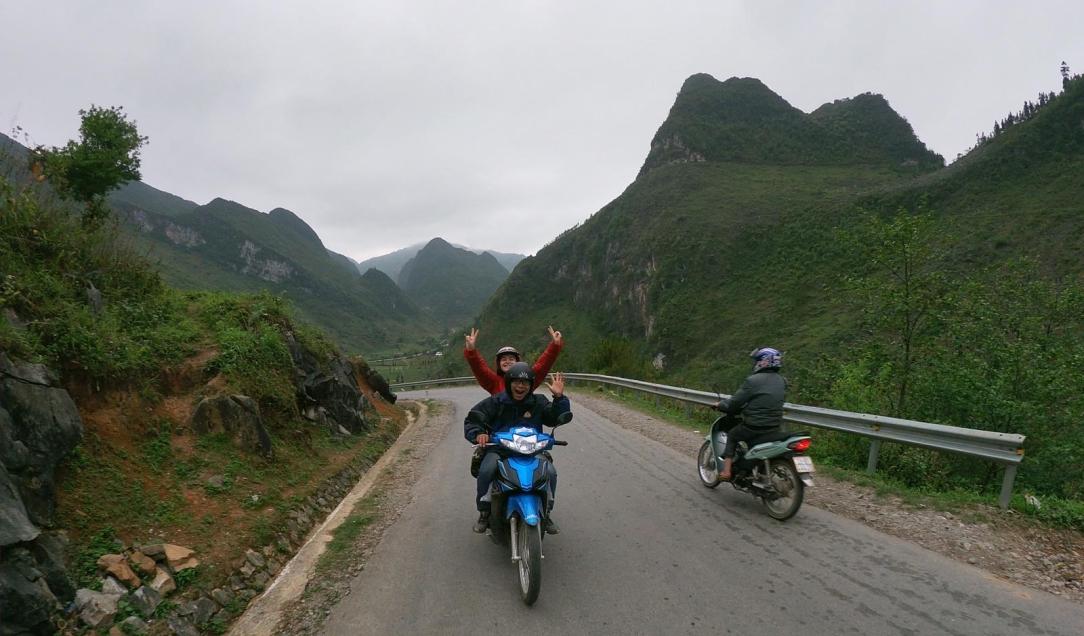 Rosa riding through Ha Giang Loop > Vietnam > TheRoamingNoodle